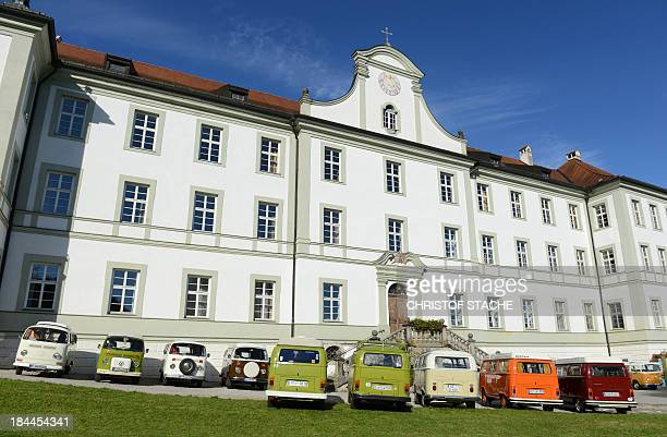 Vintage Volkswagen buses stand in front of the abbey Schaeftlarn near Munich southern Germany during an autumn rally of socalled 'Bulli' enthousiasts...