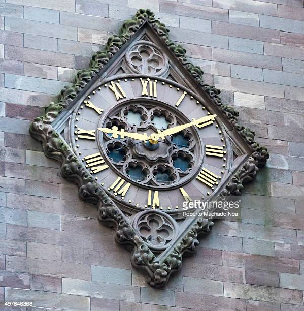 Vintage wall art New York City Antique clock embedded on wall with rhombus shape border The hands and roman numerals are gold plated