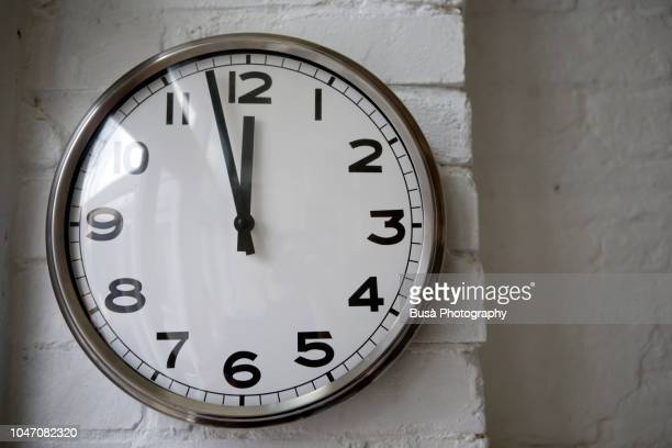 vintage wall clock in domestic setting - wall clock stock photos and pictures