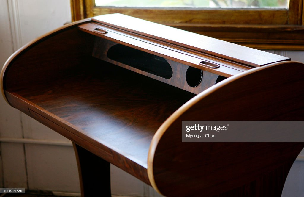 A Vintage Walnut Roll Top Desk With Cubby Holes Is Among The Refurbished Furniture