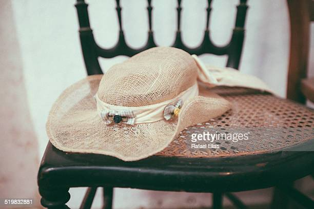 Vintage wide brimmed sun hat on wooden chair