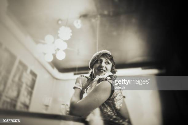 Vintage woman at bar counter drinking champagne and waiting