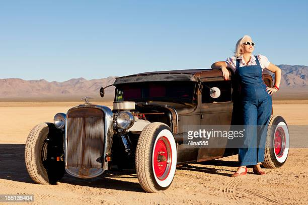 Vintage woman next to a classic car