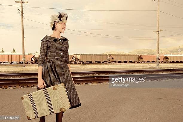 Vintage Woman With Suitcase Waiting For A Train