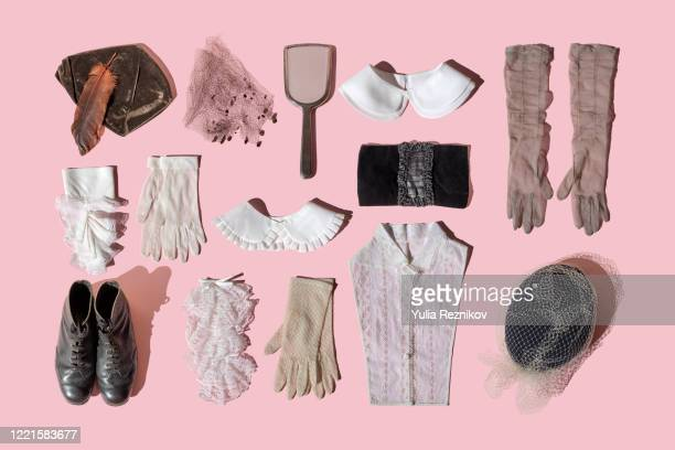 vintage women's clothing and accessoires on the pink background - レディースデー ストックフォトと画像