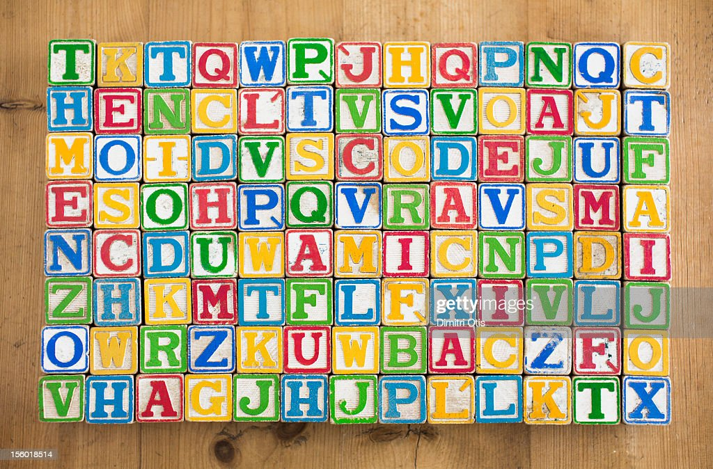 Vintage wooden alphabetic letters play blocks : Stock Photo