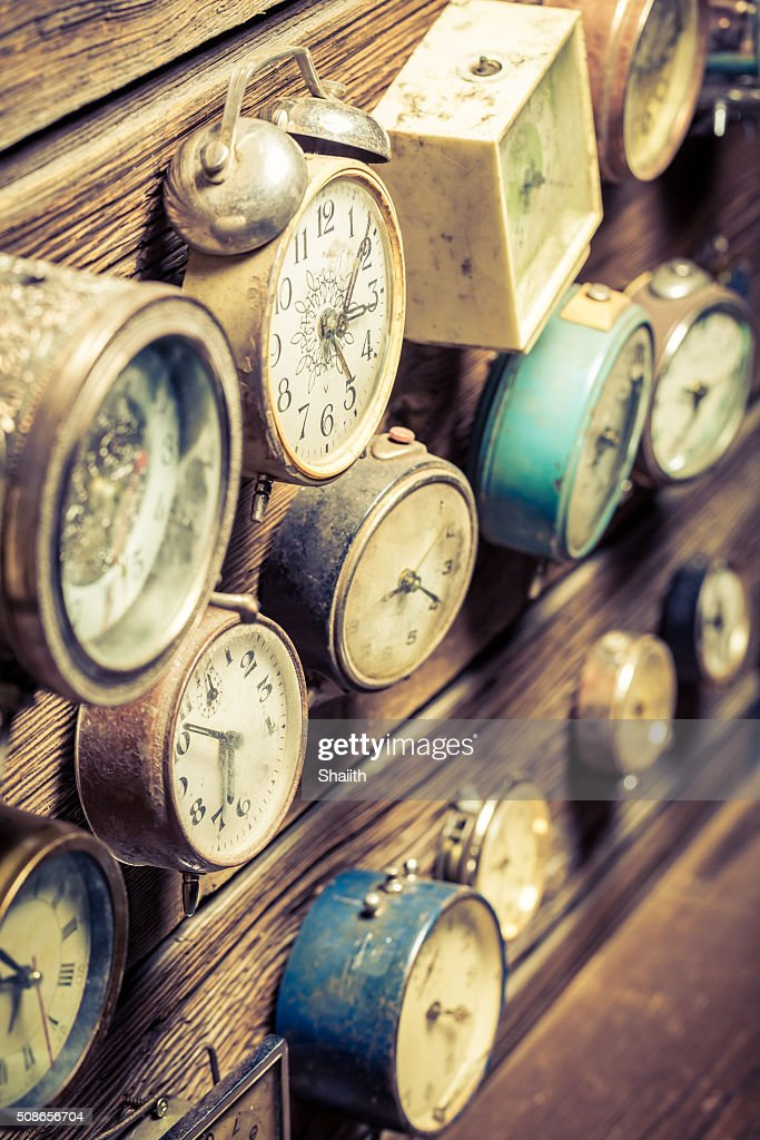 Vintage wooden wall with clocks : Stock Photo