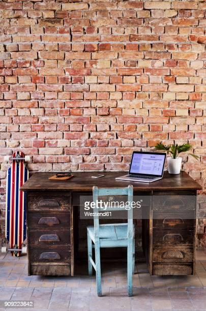 Vintage workspace at brick wall in office