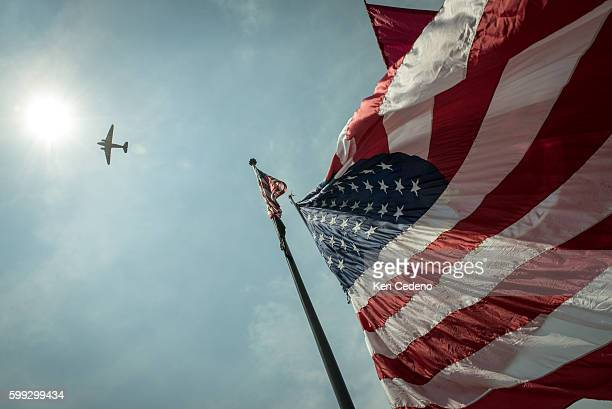A Vintage World War II planes fly over the National Mall during an array of other World War II aircraft ever assembled to fly over the National Mall...