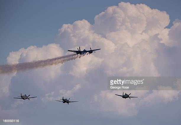 Vintage World War II planes including a P51 Mustang fighter and P38 Lightning and Hellcat bombers fly past the grandstands during the Reno National...