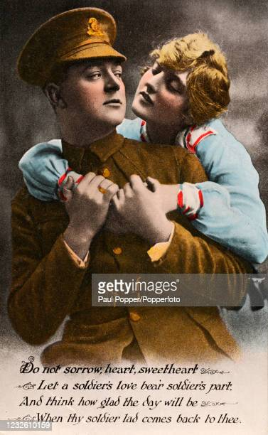 Vintage World War One Valentine postcard featuring a British soldier in uniform with his sweetheart above a love poem, published in England, circa...