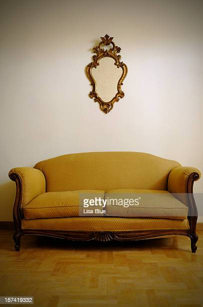 vintage yellow sofa and gold mirror - art deco furniture stock pictures, royalty-free photos & images