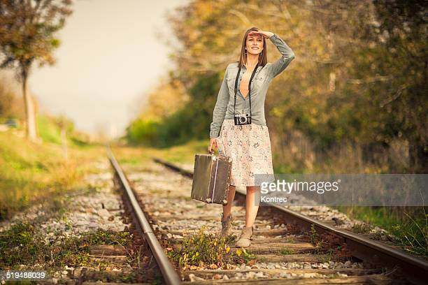 Vintage young woman on railroad tracks