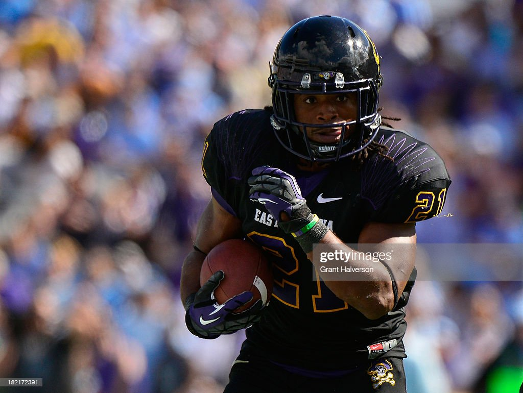 Vintavious Cooper #21 of the East Carolina Pirates runs against the North Carolina Tar Heels during play at Kenan Stadium on September 28, 2013 in Chapel Hill, North Carolina. East Carolina won 55-31.
