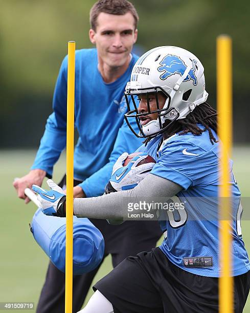 Vintavious Coopers of the Detroit Lions runs throught the drills during Detroit Lions Rookie Minicamp on May 16 2014 in Allen Park Michigan