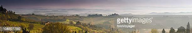 Vinyards villages misty valleys cypress trees San Gimignano Tuscany Italy