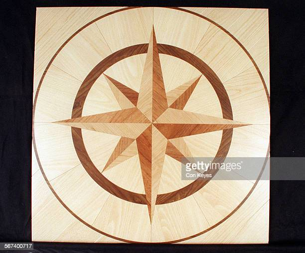 LSVinyl Flooring#10611CK/CThis is a Centre Motif Small Star with Stripwood Warm Beech and Marquetry Border This is a vinyl flooring on an individual...