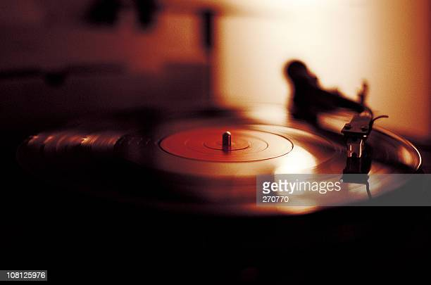 vinyl playing on record player - deck stock pictures, royalty-free photos & images