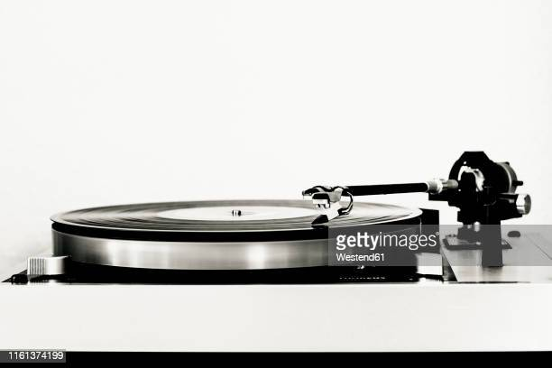 vinyl record on record player - deck stock pictures, royalty-free photos & images