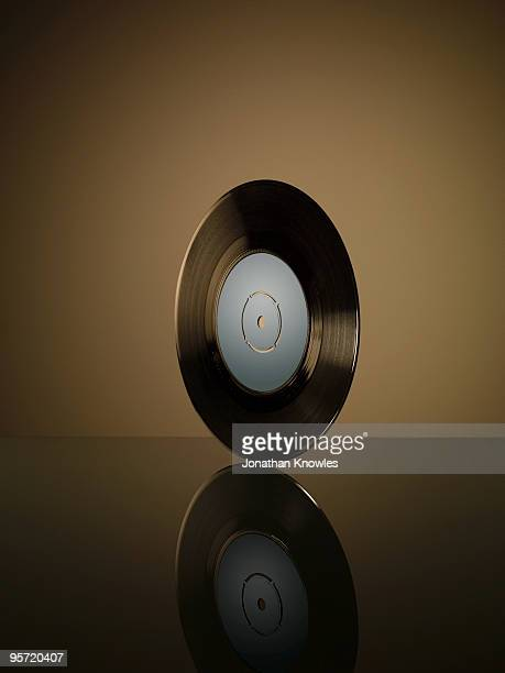 Vinyl record on reflective surface