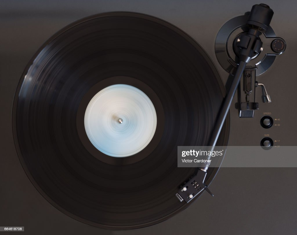 Vinyl record played on a turntable : Stock Photo