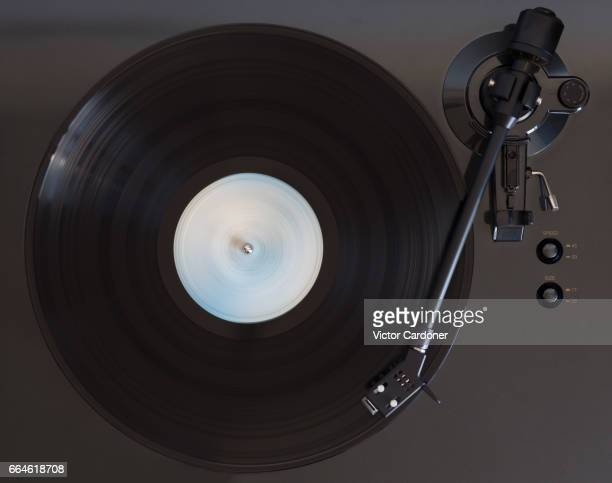 vinyl record played on a turntable - deck stock pictures, royalty-free photos & images