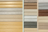 Vinyl siding with imitation wood texture in bright palette of colors. Plastic wall covering for exterior decoration of house. Abstract background for your design with copy space and place for text