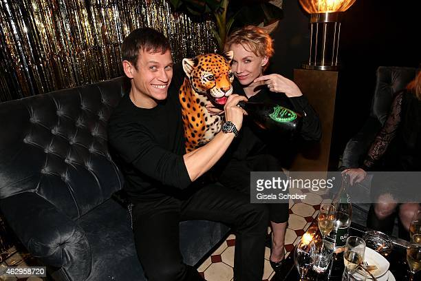 Vinzenz Kiefer and girlfriend Masha Tokareva attend the Bild 'Place to B' Party at Borchardt Restaurant on February 7 2015 in Berlin Germany