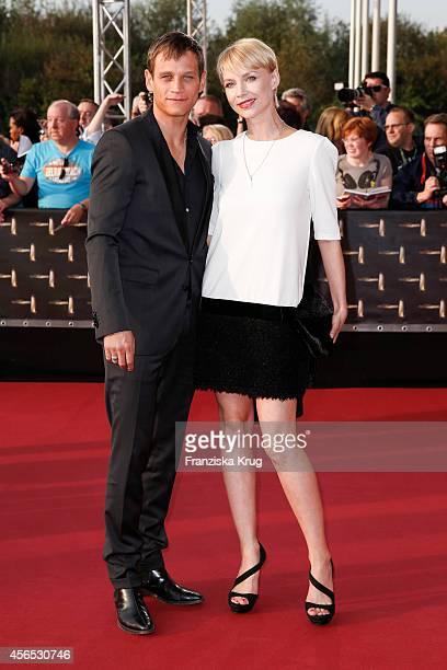 Vinzenz Kiefer and Masha Tokareva attend the red carpet of the Deutscher Fernsehpreis 2014 on October 02 2014 in Cologne Germany