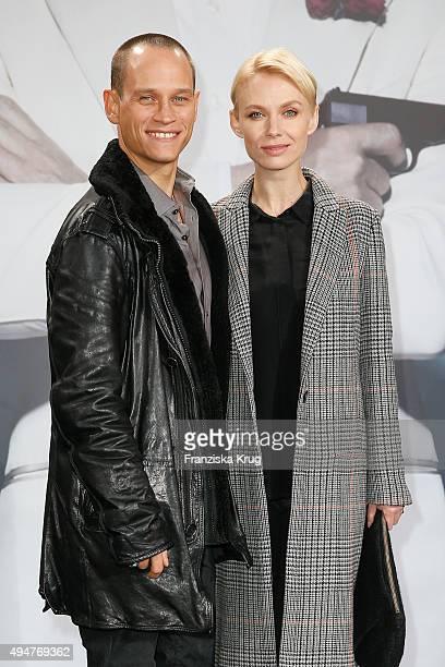Vinzenz Kiefer and Masha Tokareva attend the Spectre' German Premiere on October 28 2015 in Berlin Germany
