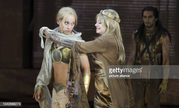 Vinzenz Kiefer as Siegfried and Cosma Shiva Hagen as Kriemhild act on stage during the photo rehearsal of this year's play of the Nibelung Festival...