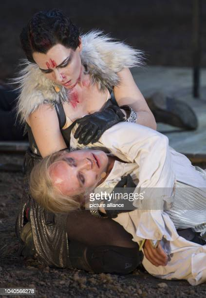 Vinzenz Kiefer as Siegfried and Kathrin von Steinburg as Brunhild act on stage during the photo rehearsal of this year's play of the Nibelung...