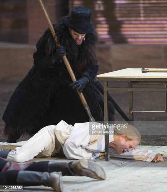 Vinzenz Kiefer as Siegfried and Lars Rudolph as Hagen act on stage during the photo rehearsal of this year's play of the Nibelung Festival 'Hebbel's...