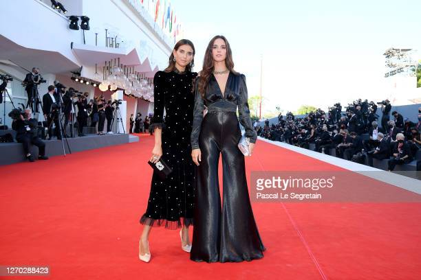"""Viola and Vera Arrivabene walk the red carpet ahead of the Opening Ceremony and the """"Lacci"""" red carpet during the 77th Venice Film Festival at on..."""