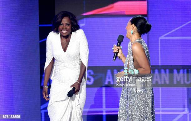 Viola Davis and host Tracee Ellis Ross speak onstage during the 2017 American Music Awards at Microsoft Theater on November 19 2017 in Los Angeles...