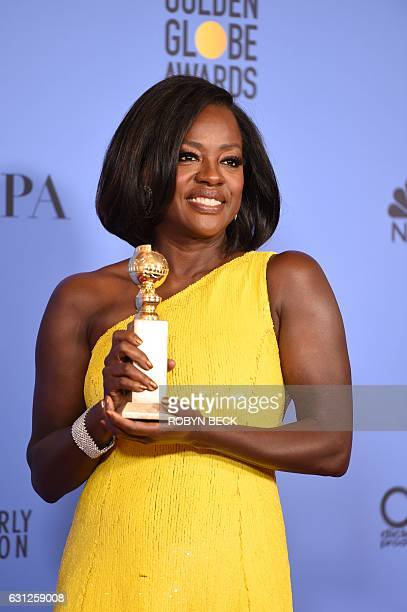Viola Davis poses with the award for Best Supporting Actress for her role in Fences, in the press room at the 74th annual Golden Globe Awards,...