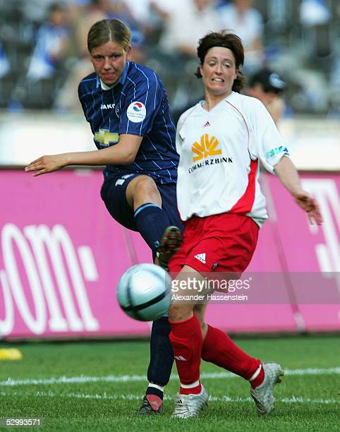 Viola Odebrecht of Potsdam challenges for the ball with Renate Lingor of Frankfurt during the women German Football Federations Cup Final between...