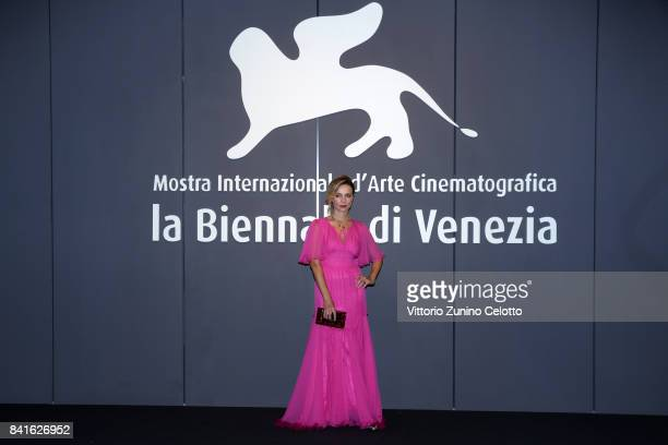 Violante Placido walks the red carpet ahead of the 'Nato A Casal Di Principe' screening during the 74th Venice Film Festival at Sala Giardino on...