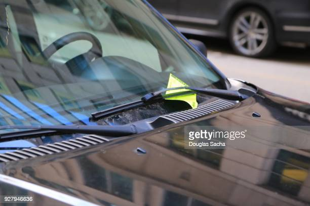 violation ticket for illegal parking on a vehicles windshield - ticket stock pictures, royalty-free photos & images