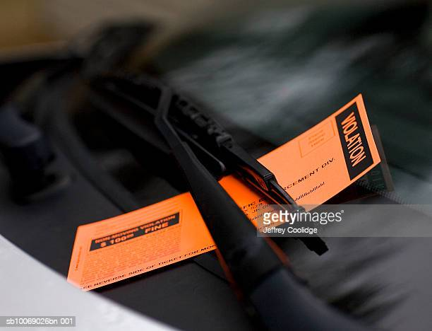 Violation ticket on windshield, close-up
