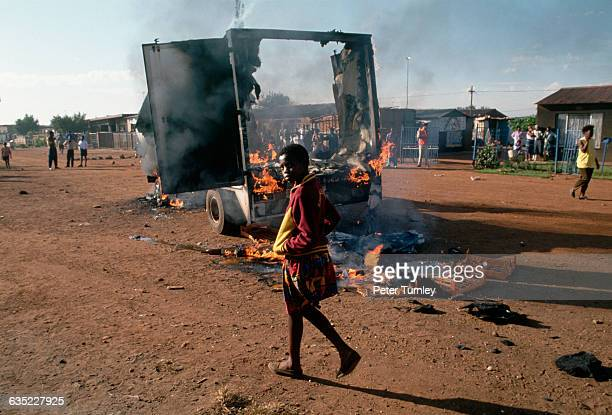 Violence between supporters of the African National Congress and the Inkatha Freedom Party is evident by this burning truck in a township outside...