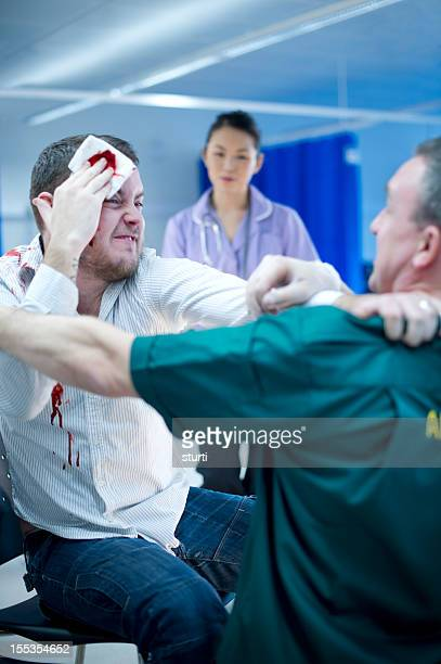 violence to hospital staff - violence stock photos and pictures
