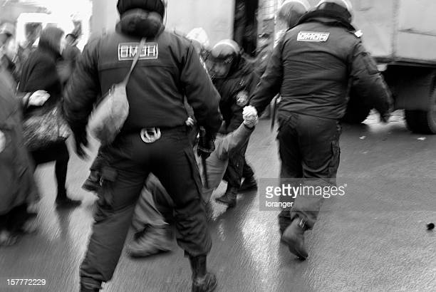violent arrest - riot police stock pictures, royalty-free photos & images