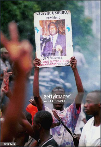 Violent clashes in Abidjan Cote d'Ivoire on October 25 2000 Plateau neighborhood Demonstrators face position in front of the national radio site