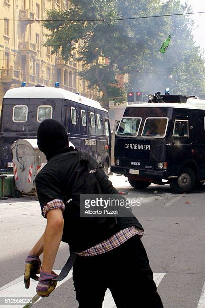 Violent clashes in the streets of Genoa between antiglobalization demonstrators and the police