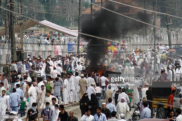 Violent protests broke out after thousands of People offered Eid prayers at Eid gah's area on August 20, 2012 in Srinagar, India. One police vehicle...