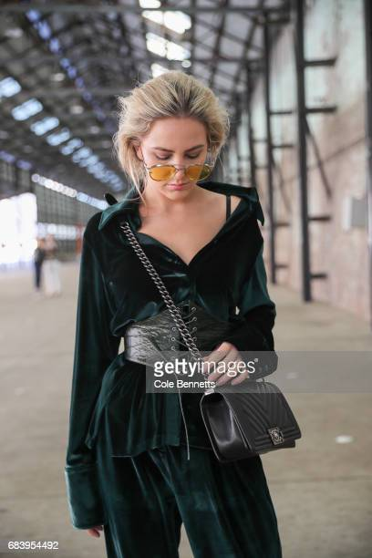 Violet Atkinson wearing Isabelle Quinn suit and corset Chanel Bag and Tony Bianco shoes during MercedesBenz Fashion Week Resort 18 Collections at...