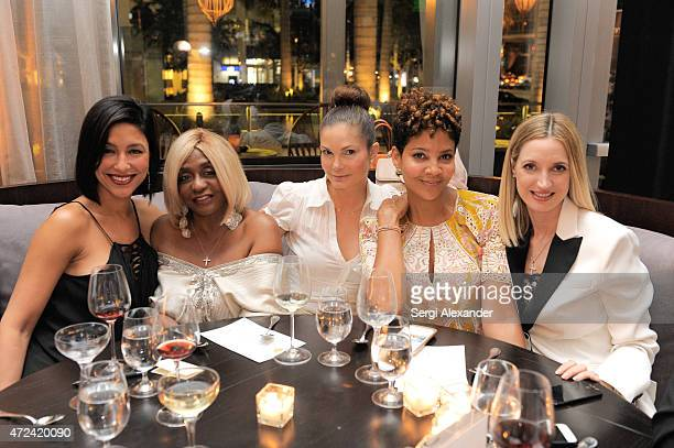 Violet Camacho Janice Mamma Combs Alicia Piazza Tracy Mourning and Hadley Henriette attend Haute Living Haute 100 Dinner presented by Dom Perignon at...