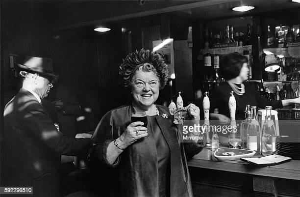 Violet Carson who recevied the OBE from the Queen at Buckingham Palace this morning has a milk stout in the Old Bell Public House near the Strand...