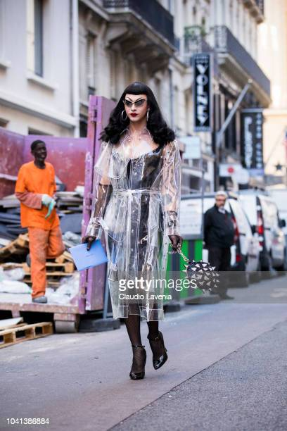 Violet Chachki wearing a black dress a seethrough trench coat black heels and black gloves is seen after the Mugler show on September 26 2018 in...
